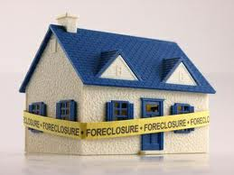 house with foreclosure tape.jpg